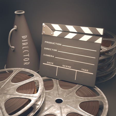 movie film reel: Clapperboard with rolls of film in the retro concept cinema. Stock Photo