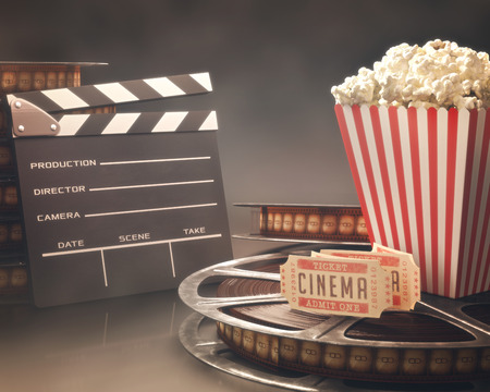 retro cinema: Objects related to the cinema on reflective surface