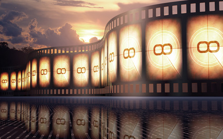 Filmstrip over the reflexive floor with sunset on the background
