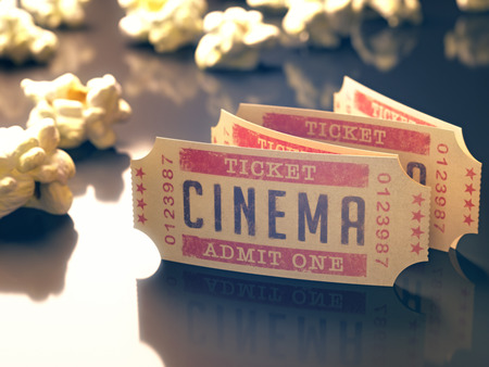 Entry ticket to the cinema with popcorn around. Clipping path included.