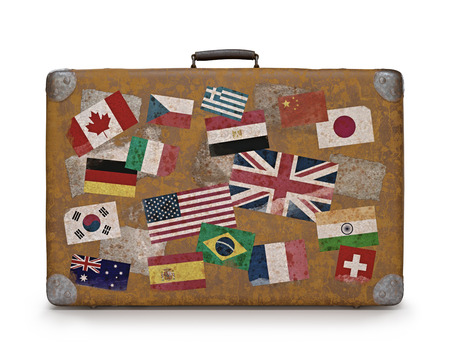 traveled: Antique suitcase with stamps flags representing each country traveled  Clipping path included