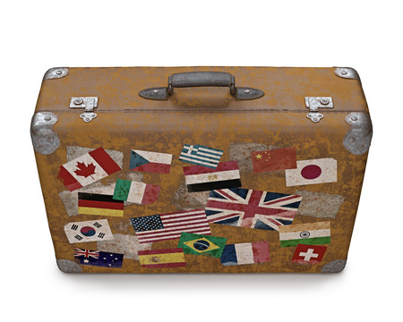 Antique suitcase with stamps flags representing each country traveled  Clipping path included  photo