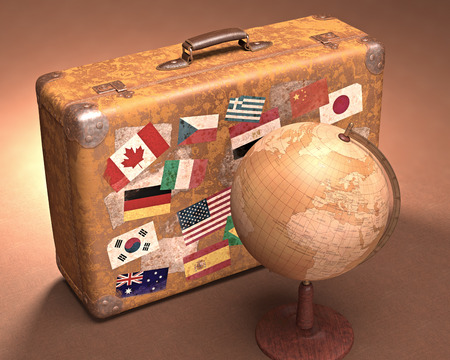 flag of spain: Antique globe in front of a retro suitcase. Travel concept around the world.