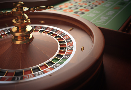 roulette wheel: Playing roulette in the casino. Depth of field in the ball. Stock Photo