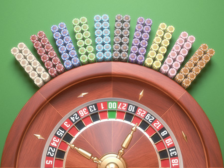 Colored casino chips arranged around the roulette.
