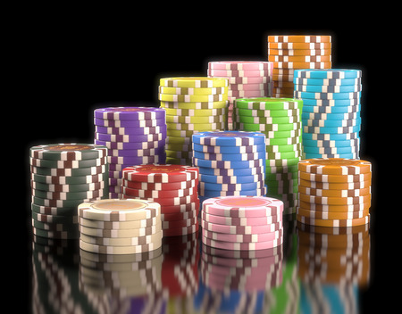 Colorful chips on black background. Concept of casino and gambling. Clipping path on the chips.
