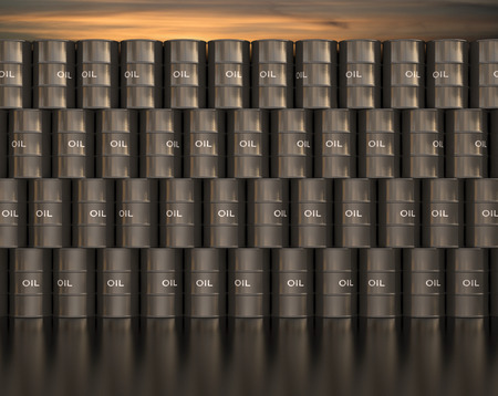 refine: Stacks barrel of oil with sunset in the background. Stock Photo