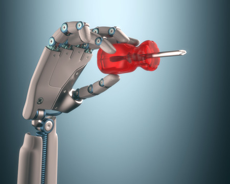 automation: Robot hand holding a screwdriver on the concept of industrial automation.