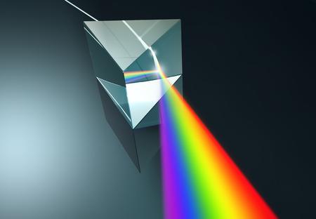 El prisma de cristal dispersa la luz blanca en muchos colores. Foto de archivo