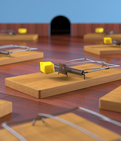 mouse hole: Several mousetrap with cheese on a wooden floor. Depth of field in cheese. Stock Photo