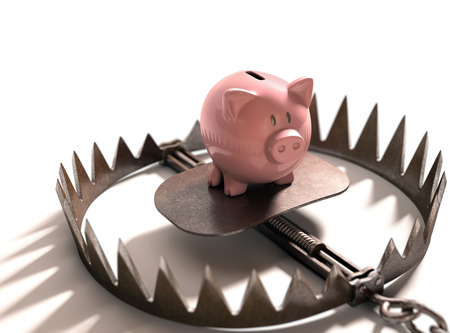 Piggy bank in the bear trap on white background. photo