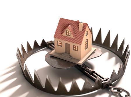 Bear trap with a house inside. Concept of mortgage, pledge and property financing. 版權商用圖片