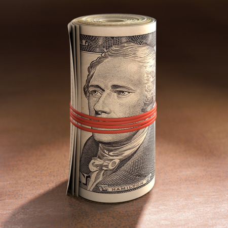 Money roll with elastic gagging the mouth of Alexander Hamilton. Stock Photo