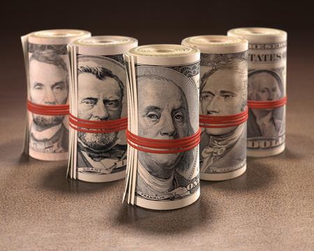 alexander hamilton: Soldi rotola con conati di vomito elastico le bocche dei simboli della valuta degli Stati Uniti. Archivio Fotografico