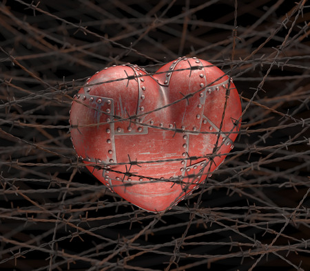 Metal heart with barbed wire around. photo