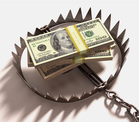 trap: Stack of US dollars into a trap. Clipping path included.