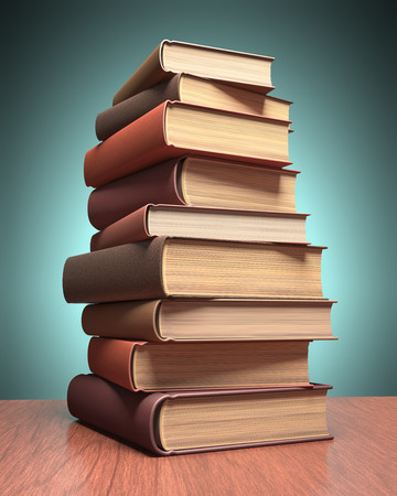 encyclopedic: Several books stacked on the table. Clipping path included. Stock Photo