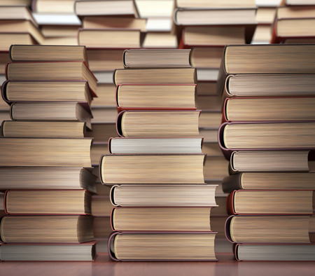 encyclopedic: Several books stacked on the table. Stock Photo