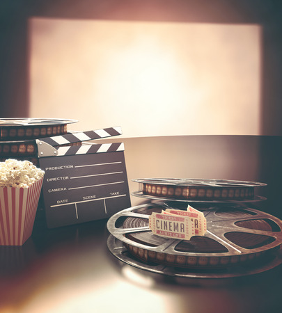 film: Objects related to the cinema on reflective surface.