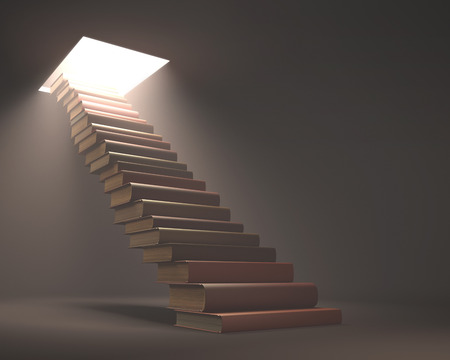 Books stacked ladder shaped on a concept of knowledge and growth.
