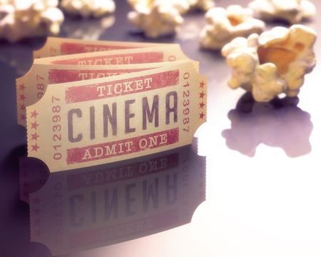 cinema ticket: Entry ticket to the cinema with popcorn around.
