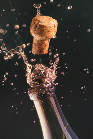 popping cork: Opening a bottle of champagne. Celebration concept.