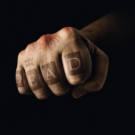 closed fist: Closed fist with death tattoo on the fingers. Concept of violent sports.