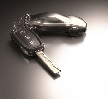 lock and key: Key car and key ring over the metallic table. Clipping path included. Stock Photo