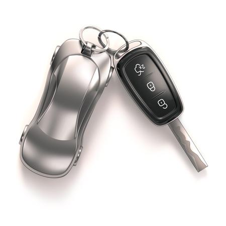 Clé de voiture et porte-clés sur fond blanc. Chemin de détourage inclus.