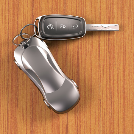 car keys: Key car and key ring over the table. Clipping path included. Stock Photo