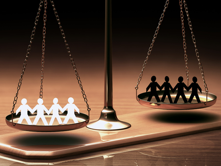 discrimination: Scales of justice equaling races without prejudice or racism. Clipping path included. Stock Photo
