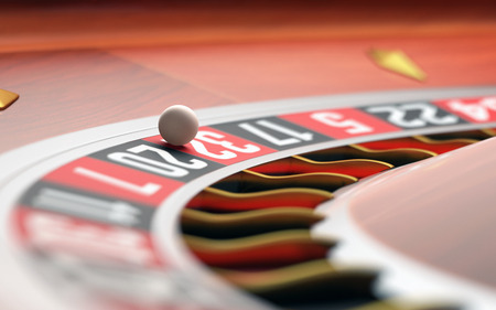 wager: Playing roulette in the casino. Depth of field with focus on the ball. Stock Photo