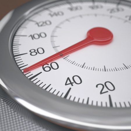 weight gain: Weight scale measuring weight gain above 60kg. Depth of field on 60 kg.