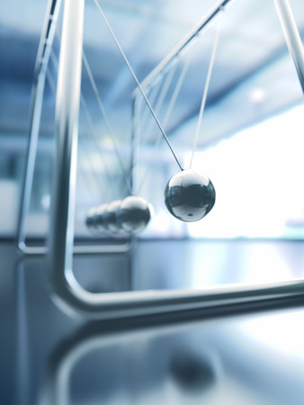 momentum: 3D illustration of Newtons cradle, concept of conservation of momentum and energy. Stock Photo