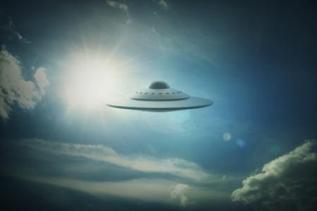ufology: 3D illustration with photography. Alien spaceship under the sun. Stock Photo
