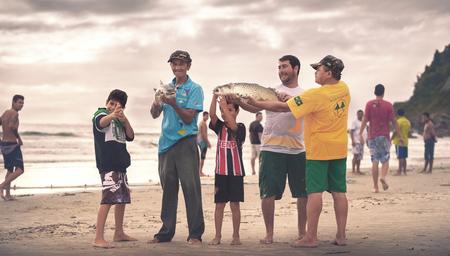 Ilha Do Mel, Paraná, Brazil - June 3, 2017: Native fishermen from Ilha do Mel (Honey Island) holding fish for the photo. Banco de Imagens - 80067648
