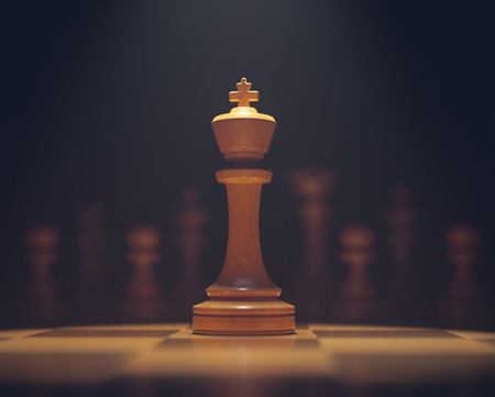 The king in highlight. Pieces of chess game, image with shallow depth of field.