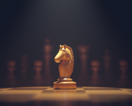 The knight in highlight. Pieces of chess game, image with shallow depth of field. Imagens