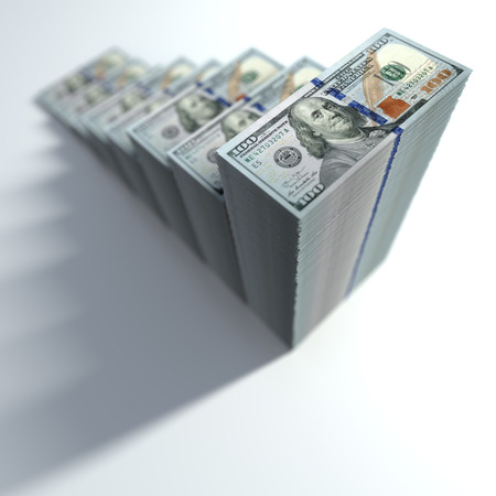 Dollar bills stacked in shape of growing bar chart. Concept of success in business.