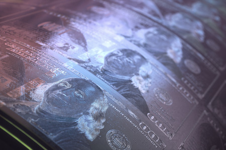 Concept image of a one hundred dollar bill print roller. Stock Photo