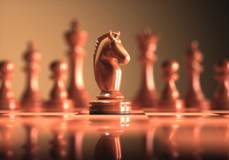 The Knight in highlight. Pieces of chess game, image with shallow depth of field. Stock Photo