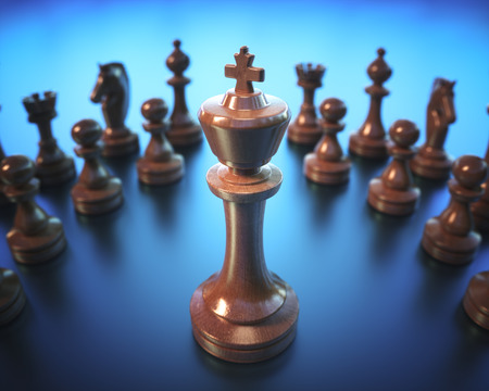 The King in highlight. Pieces of chess game, image with shallow depth of field. Stock Photo