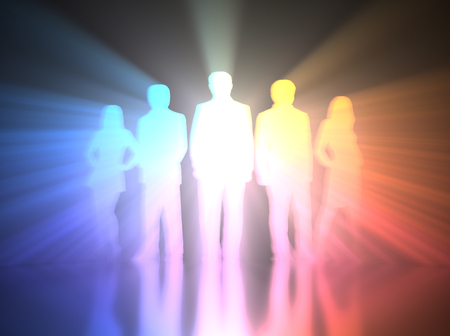 Silhouette of a teamwork with back light projecting colorful volume light. Stock Photo