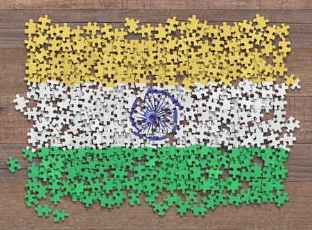 Flag of the India in disorganized pieces of a puzzle.