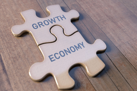 Concept image of economy and growth using parts of a puzzle. Teamwork and good relations in the economy.