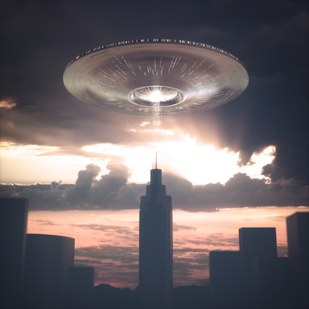 Alien spacecraft flying over building at sunset. Image concept of alien invasion. Stock Photo