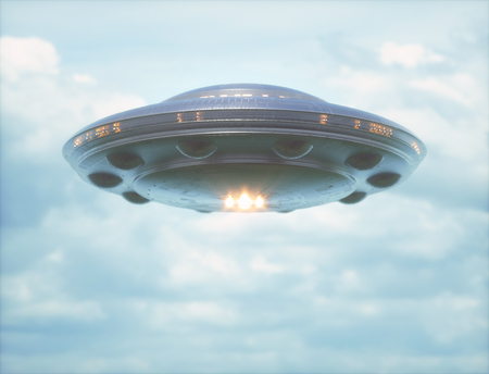 Unidentified flying object in cloudy sky with strong lights pointed towards the camera. Stock Photo