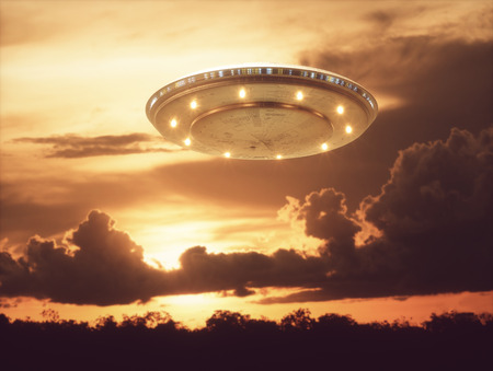 Unidentified flying object, UFO with the sunset in the background. Stock Photo