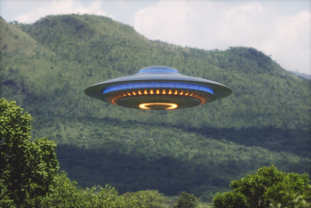 Unidentified flying object over a forest with trees and mountains behind.