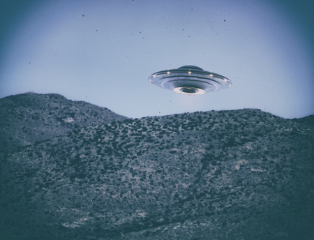 Unidentified flying object UFO. Old style photo with high ISO noise and dirt with scratches over time. Clipping path included. Stock Photo
